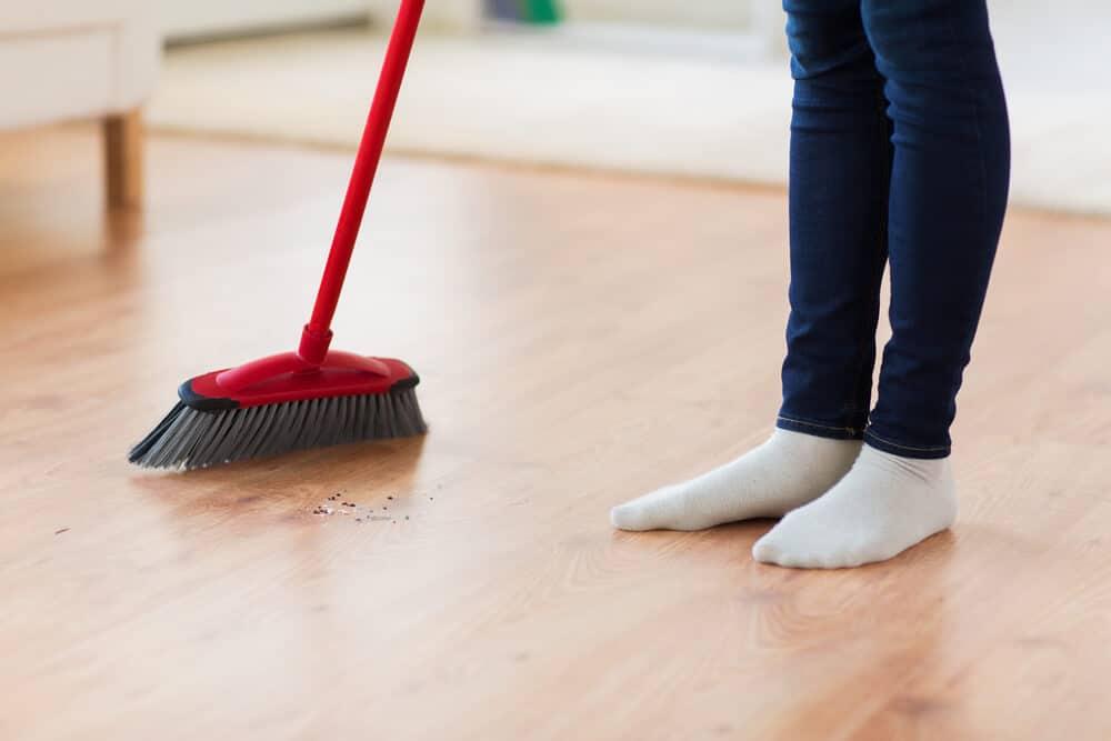 sweeping damaged wood floor